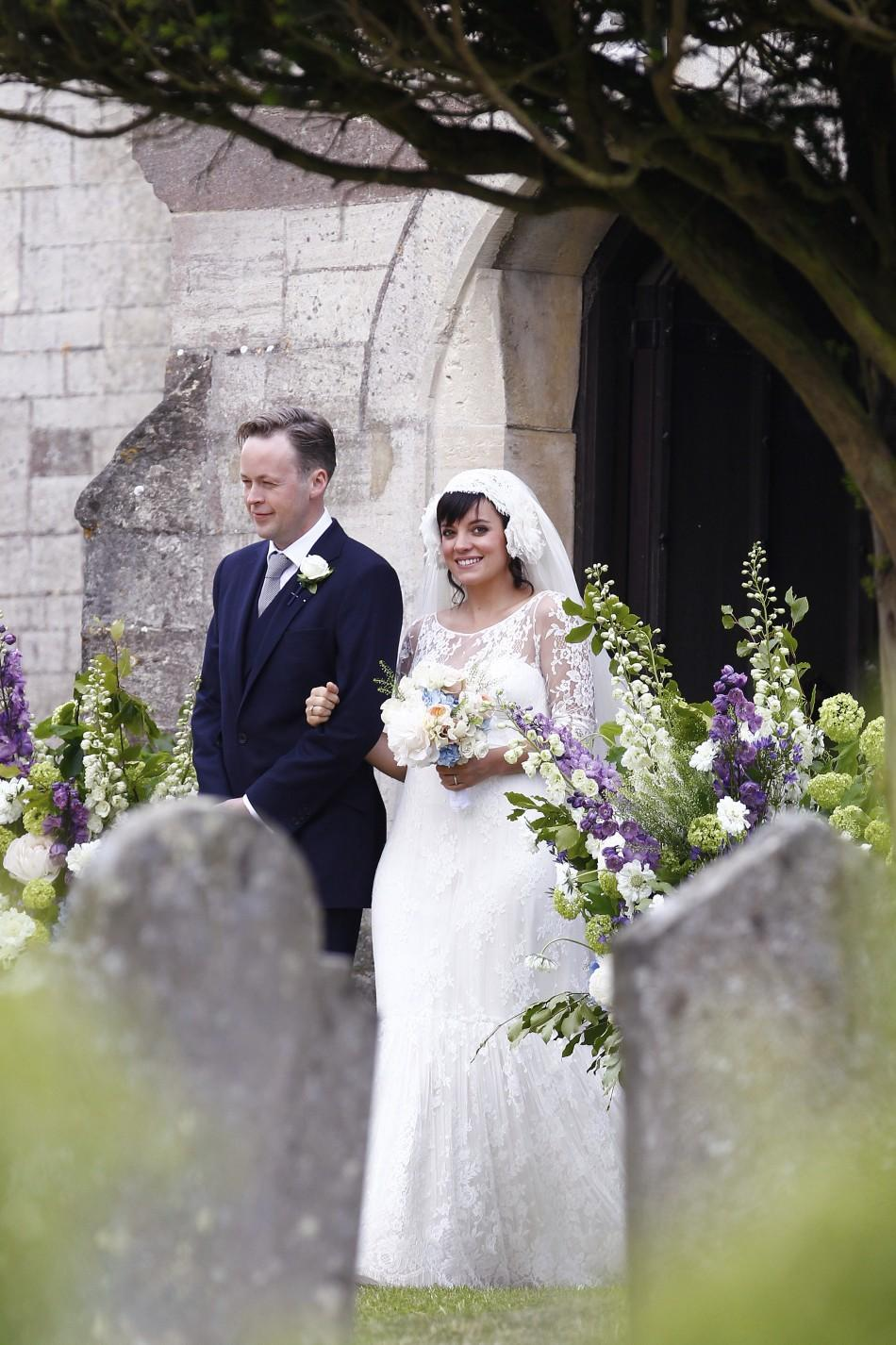 British Singer Lily Allen smiles after marrying Sam Cooper as the couple leaves St James the Great Church in Cranham, Goucestershire, western England, June 11, 2011.