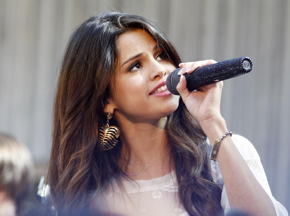 "Singer and actress Selena Gomez performs during an appearance at the Santa Monica Place mall promoting her new movie ""Monte Carlo"" in Santa Monica"