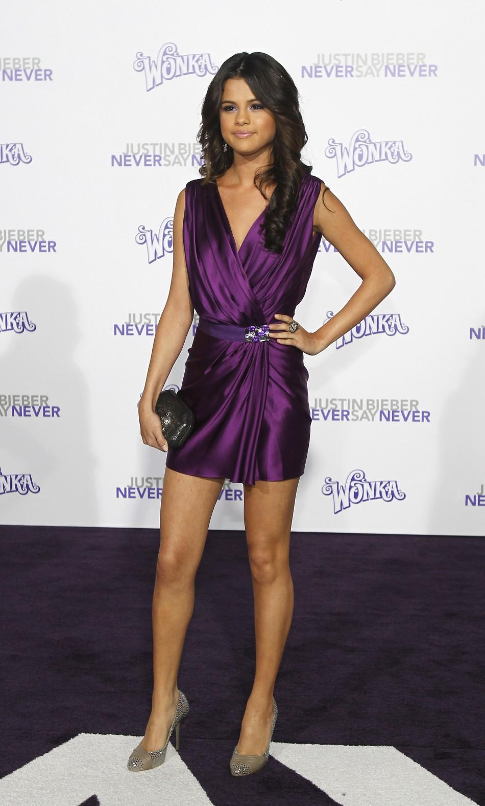 "Gomez poses at the premiere of ""Justin Bieber: Never Say Never"" at Nokia theatre in Los Angeles"