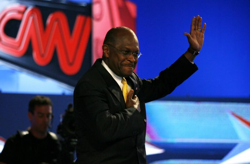 Republican presidential hopeful Herman Cain waves during photo opportunity before the first New Hampshire debate of the 2012 campaign in Manchester