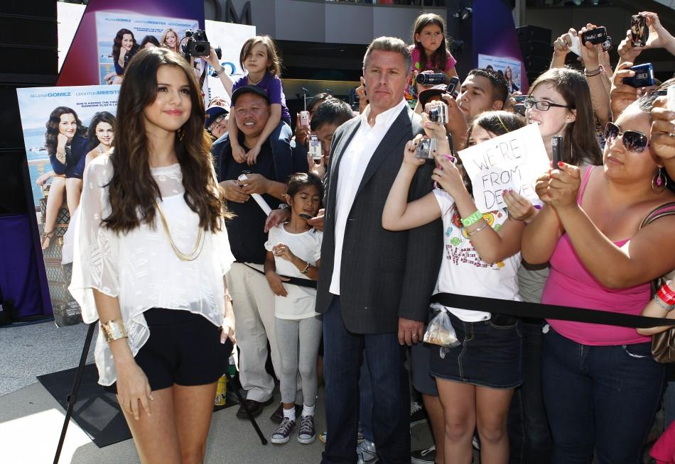 "Singer and actress Selena Gomez poses for photographers during an appearance at the Santa Monica Place mall to promote her new movie ""Monte Carlo"" in Santa Monica, California June 13, 2011. Gomez was due to make the promotional appearance June 1"