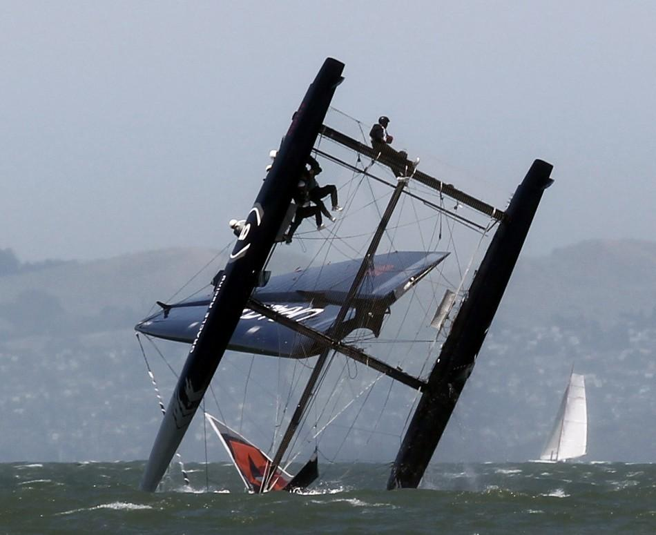 An Oracle Racing AC45 boat capsizes during an exhibition race in San Francisco Bay