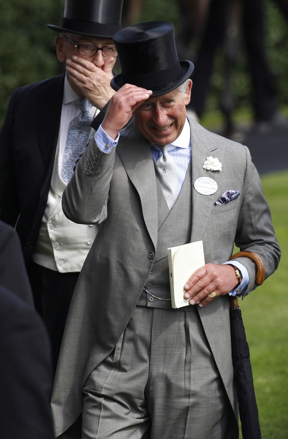 Britain's Prince Charles lifts his hat on the first day of racing at Royal Ascot in southern England