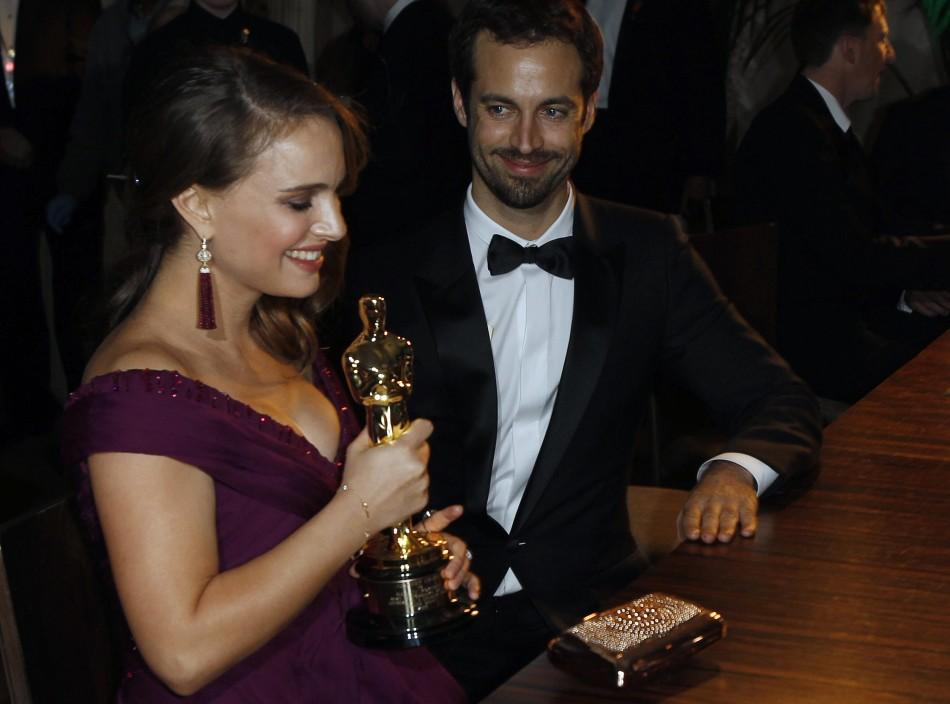 "Actress Natalie Portman holds her Oscar, which she won for best actress for her role in ""Black Swan"", after the name plate was engraved at the Governor's Ball after the 83rd Academy Awards in Hollywood, California, February 27, 2011."