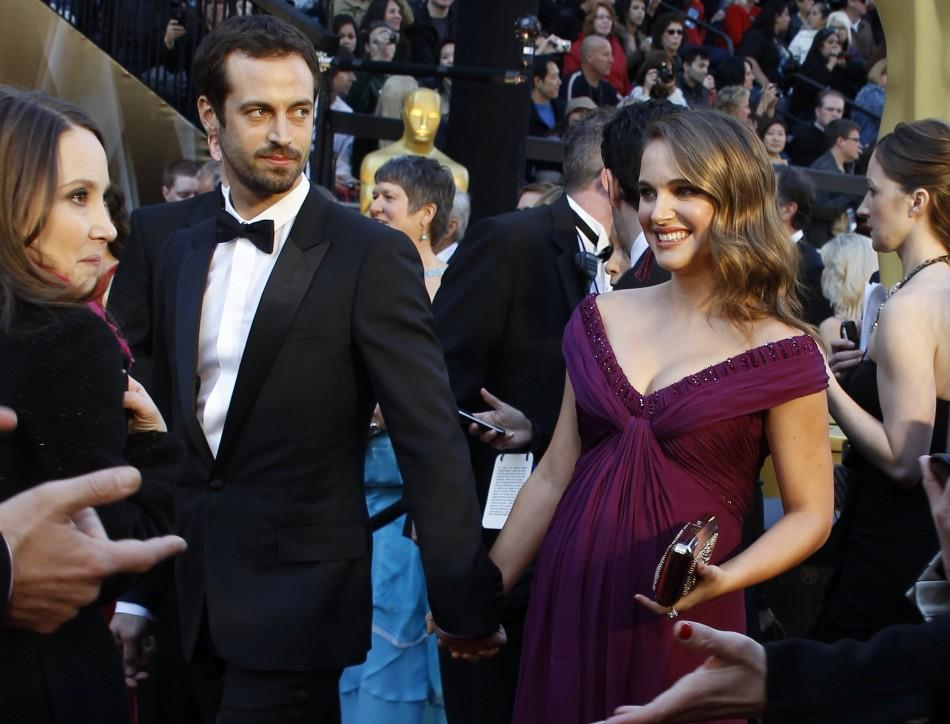 "Natalie Portman (R), best actress nominee for her role in ""Black Swan"", and her fiance, Benjamin Millepied arrive at the 83rd Academy Awards in Hollywood, California February 27, 2011."