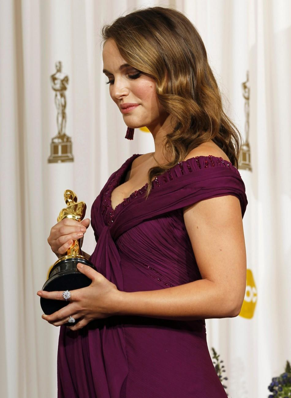 "Natalie Portman, best actress winner for her role in ""Black Swan"", poses backstage at the 83rd Academy Awards in Hollywood, California, February 27, 2011."