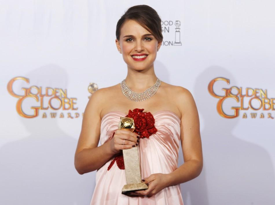 Actress Natalie Portman poses with her award for Best Performance by an Actress in a Motion Picture - Drama for 'Black Swan,' backstage at the 68th annual Golden Globe Awards in Beverly Hills, California, January 16, 2011.