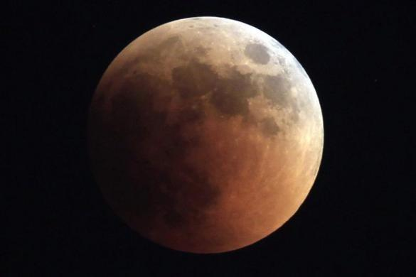 The moon is seen during a total lunar eclipse from Cairo June 15, 2011.