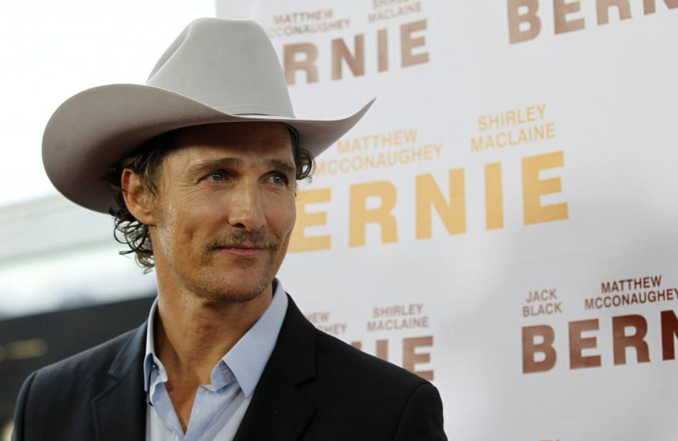 "Cast member Matthew McConaughey looks at his partner Camila Alves (not pictured) as she poses at the world premiere of ""Bernie"" during the opening night of the Los Angeles Film Festival at the Regal Cinemas in Los Angeles June 16, 2011."
