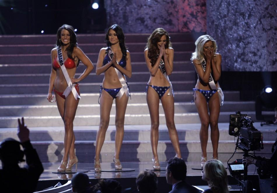 Contestants react after making the semi-final cut during the Miss USA pageant in Las Vegas