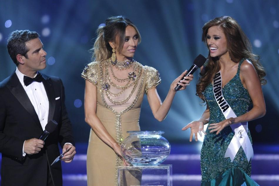 Miss California Alyssa Campanella (R) answers a question with show hosts Andy Cohen (L) and Giuliana Rancic during the 2011 Mis
