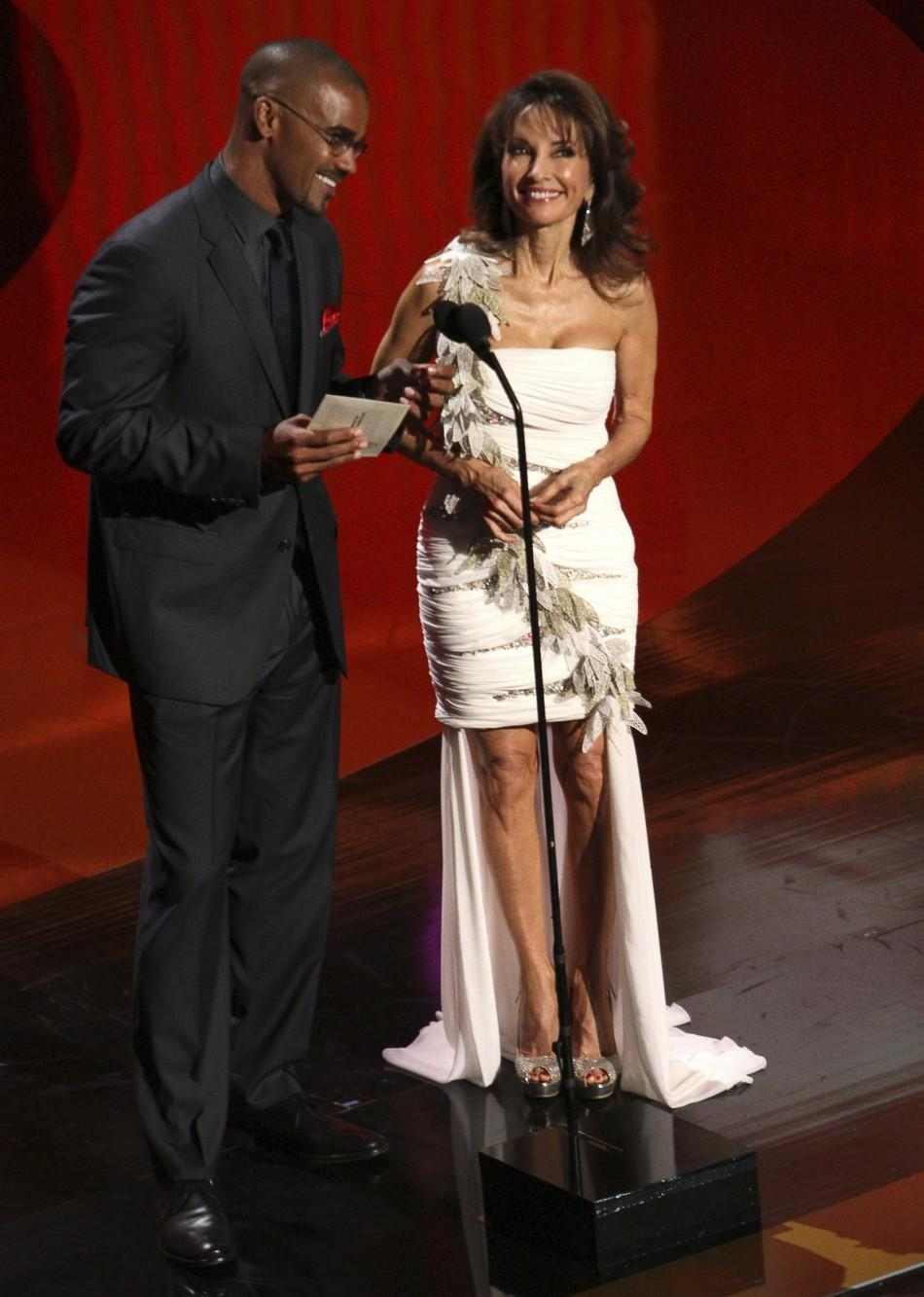 Actor Shemar Moore (L) and actress Susan Lucci speak onstage during the 38th Annual Daytime Entertainment Emmy Awards at the Las Vegas Hilton in Las Vegas, Nevada, June 19, 2011.