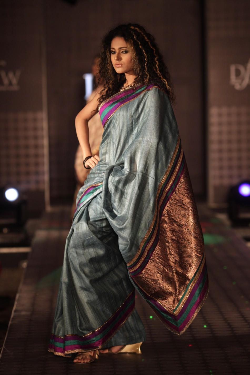 Models showcase creations by Bangladeshi fashion label Mansha during Dhaka Fashion Week