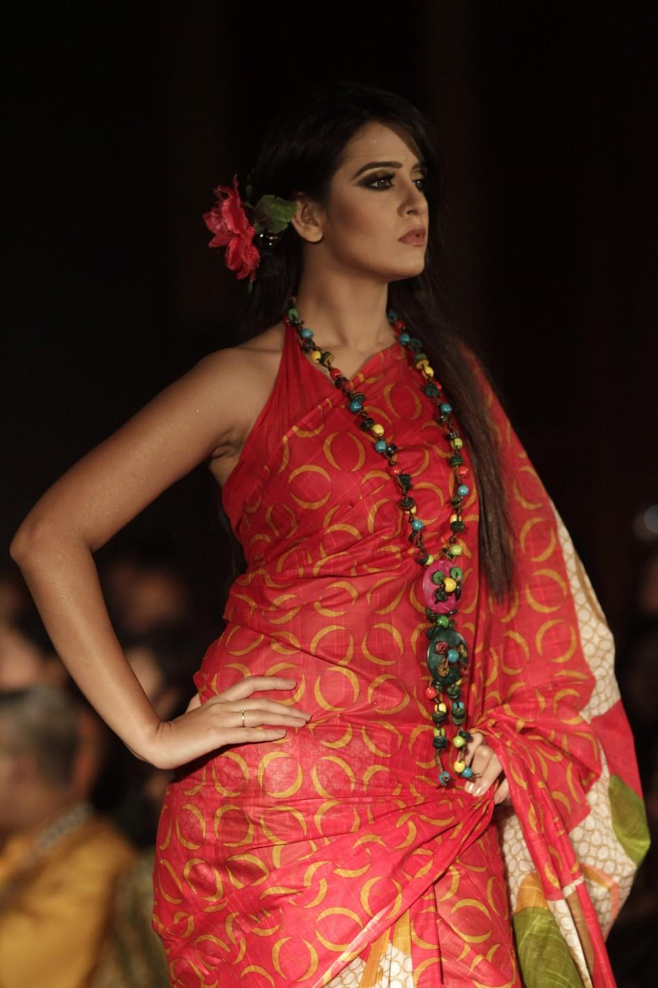 A model displays a creation by Bangladeshi label Anjan's during Dhaka Fashion Week in Dhaka