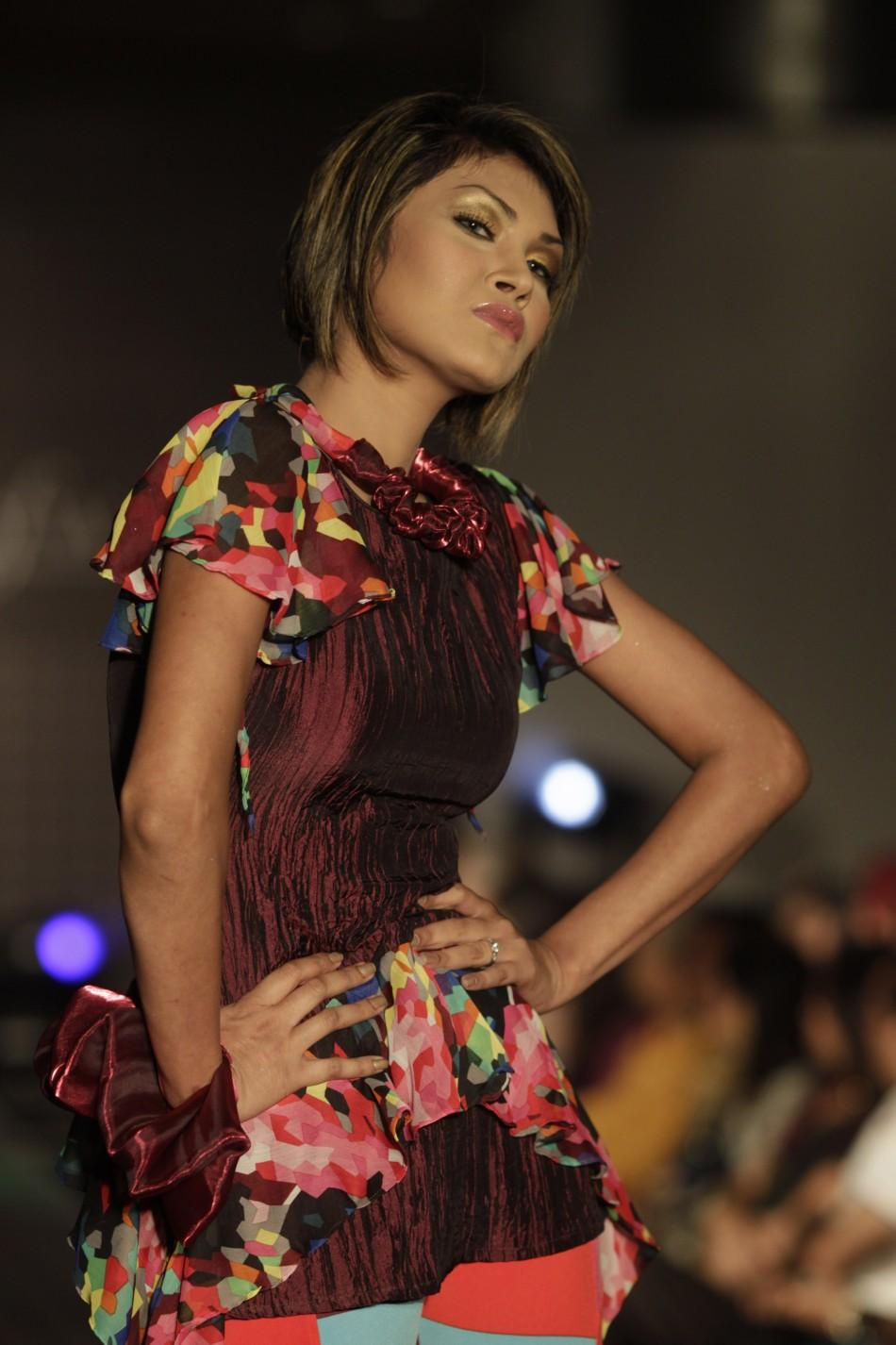 A model showcases a creation by Bangladeshi label Escape Premium during Dhaka Fashion Week