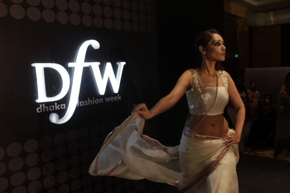A model catwalks during Dhaka Fashion Week in Dhaka