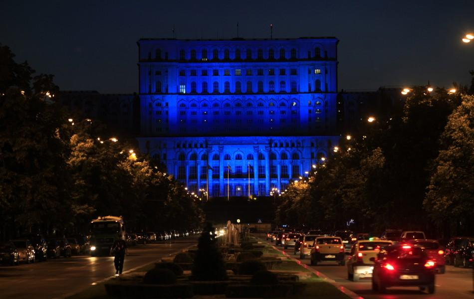 Romania's Parliament Palace, the largest administrative building in the world is lit in blue to mark the World Refugee Day in Bucharest
