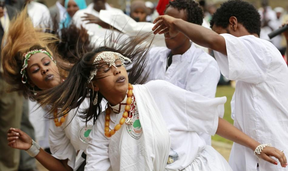 Ethiopian refugees perform traditional dance during celebrations to mark World Refugee day in Nairobi