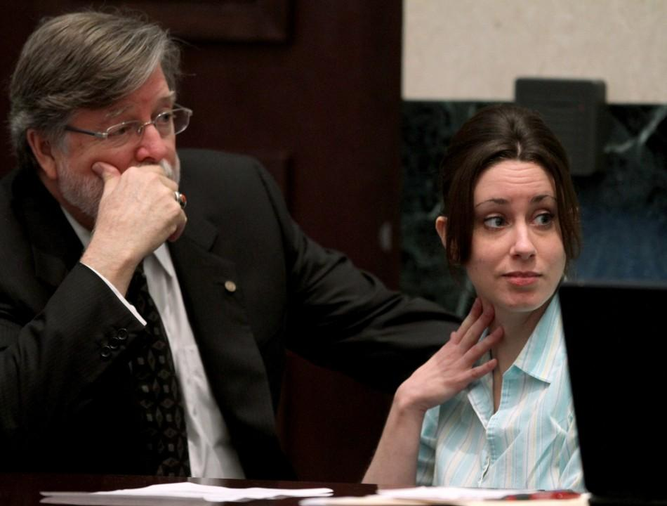 Casey Anthony, with defense counsel Cheney Mason, looks on during day 19 of her 1st-degree murder trial at the Orange County Courthouse, in Orlando, Florida