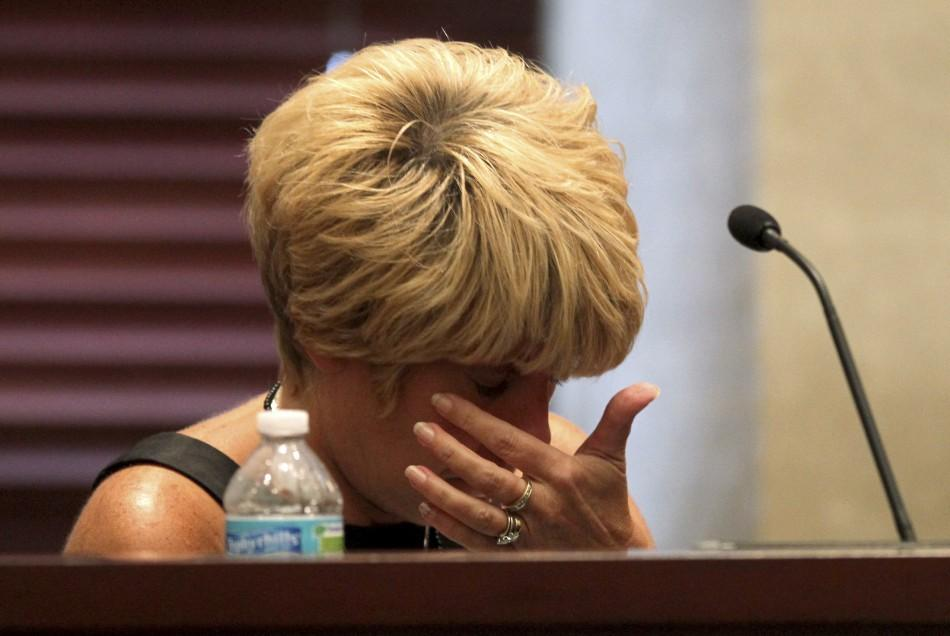 Cindy Anthony wipes away tears while testifying during her daughter Casey Anthony's first-degree murder trial in Orlando