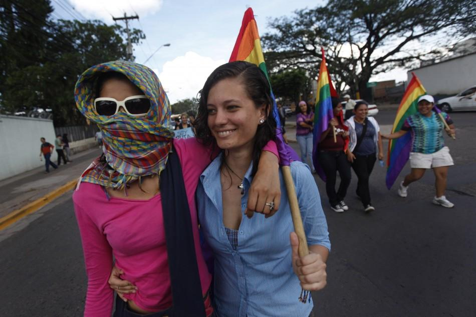 "Two women take part in the ""March of Bitches"" to protest against discrimination and violence against women in Tegucigalpa"