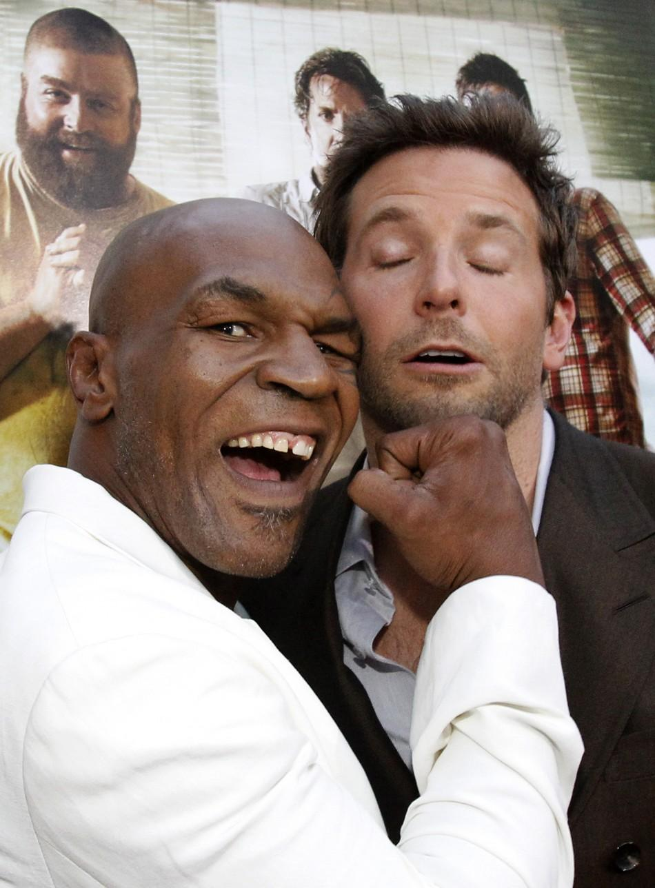 "Mike Tyson (L) jokes with cast member Bradley Cooper at the premiere of ""The Hangover Part II"" at Grauman's Chinese theatre in Hollywood, California May 19, 2011."