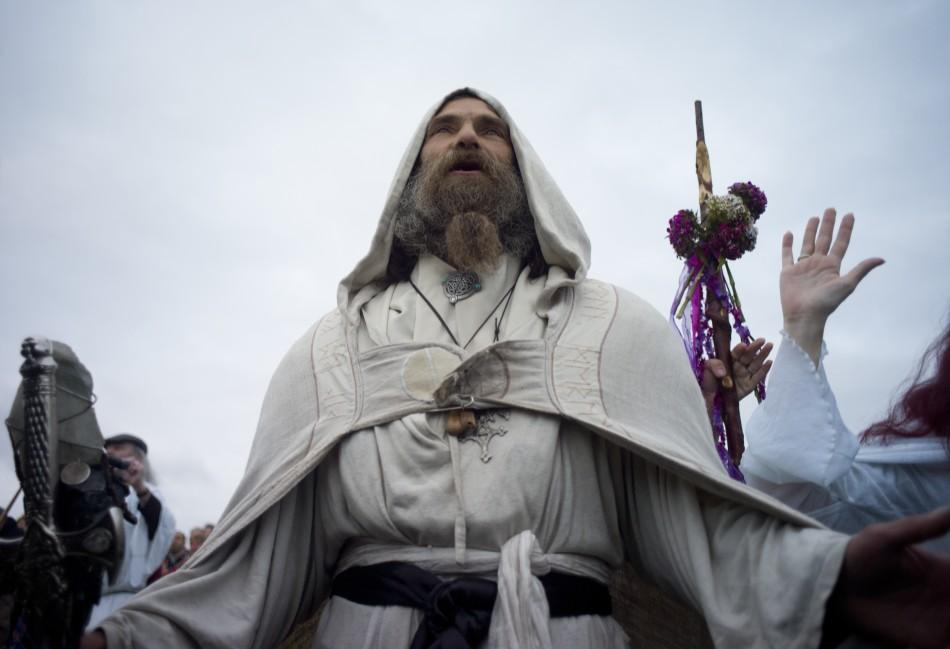 A druid prays for peace during incantations at the summer solstice ceremony at Stonehenge on Salisbury plain in southern England June 21