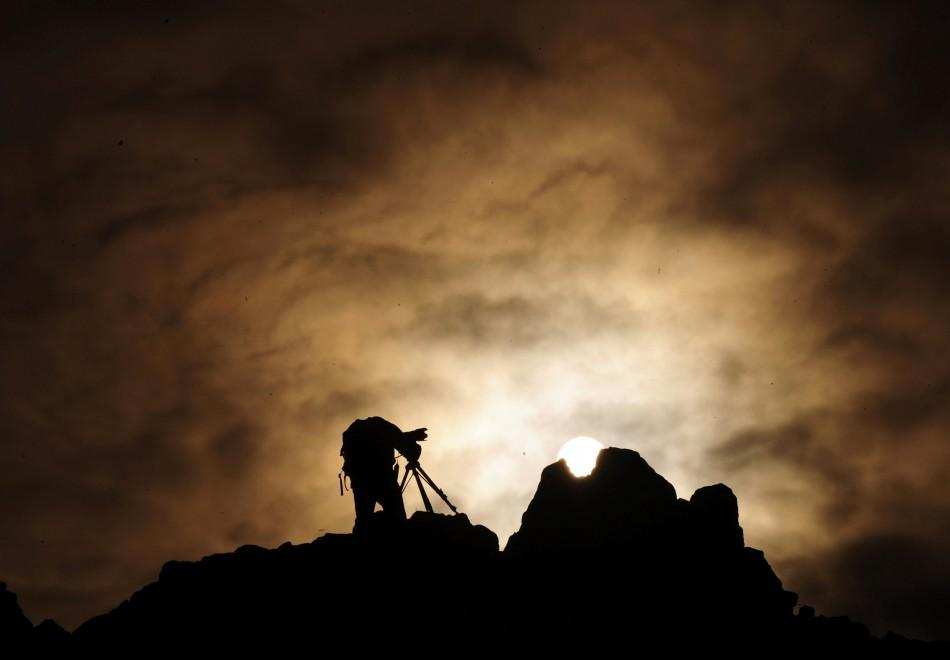 A man uses a camera on a rocky crest filled with astronomical markers during the summer solstice at the Kokino megalithic observatory June 21, 2010. The 3,800-year-old observatory was discovered in 2001 in the northwestern town of Kumanovo, 70 km (43 mile
