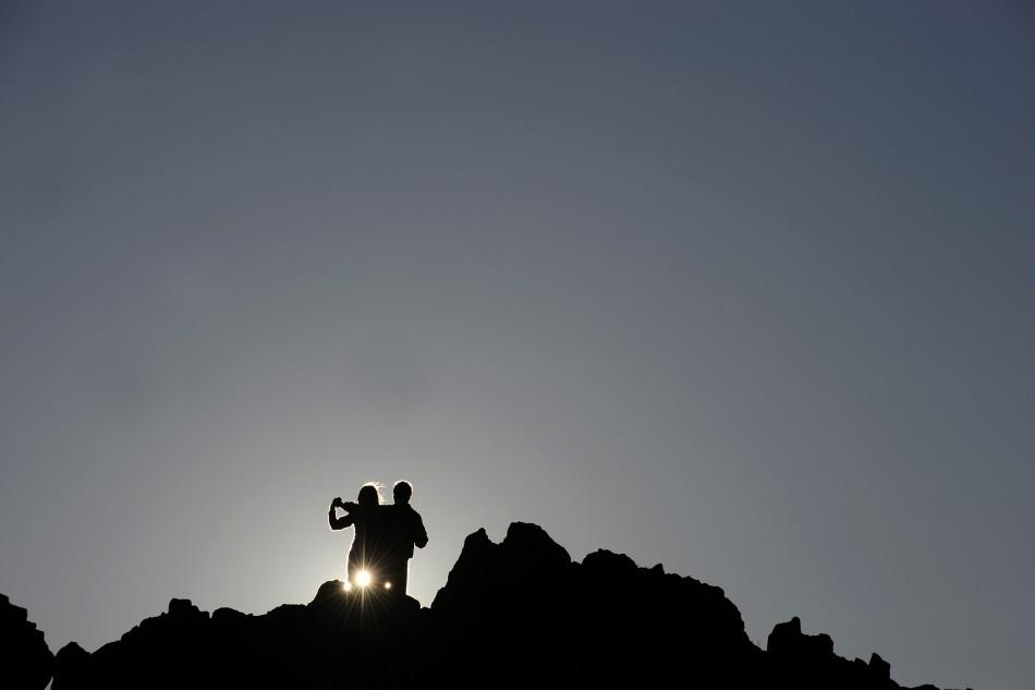A couple celebrates summer solstice at the marker for the summer solstice at the Kokino megalithic observatory June 21, 2011. The 3,800-year-old observatory was discovered in 2001 in the northwestern town of Kumanovo, 70 km (43 miles) north from Skopje, a
