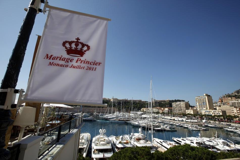 A flag announcing the wedding of Prince Albert II of Monaco and his fiancee Charlene Wittstock is seen above Monaco port