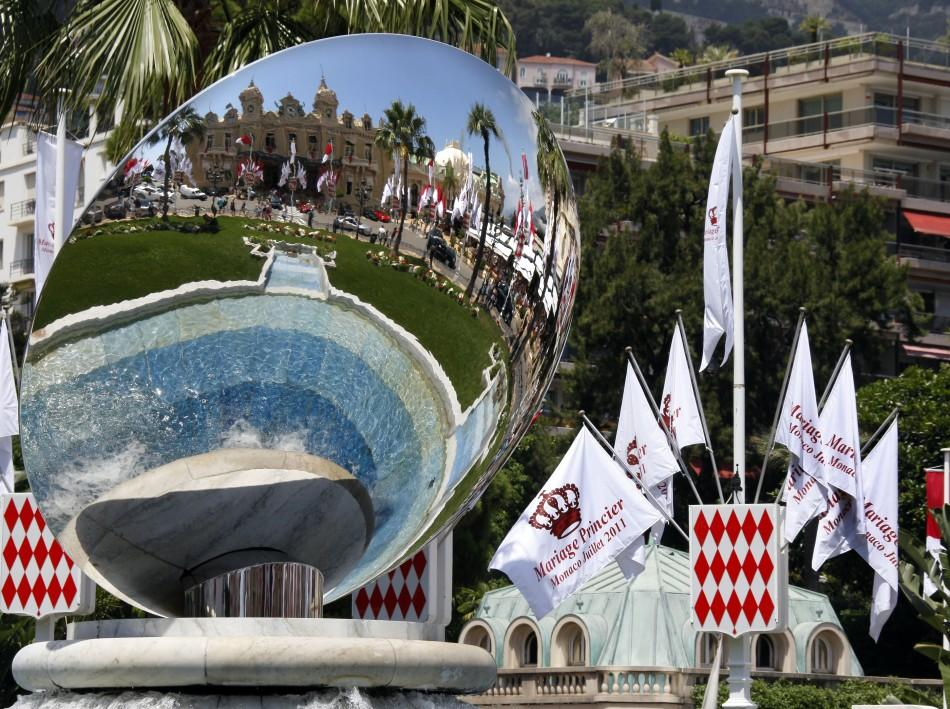 Flags announcing the wedding of Prince Albert II of Monaco and his fiancee Charlene Wittstock are seen in front of Monaco casino