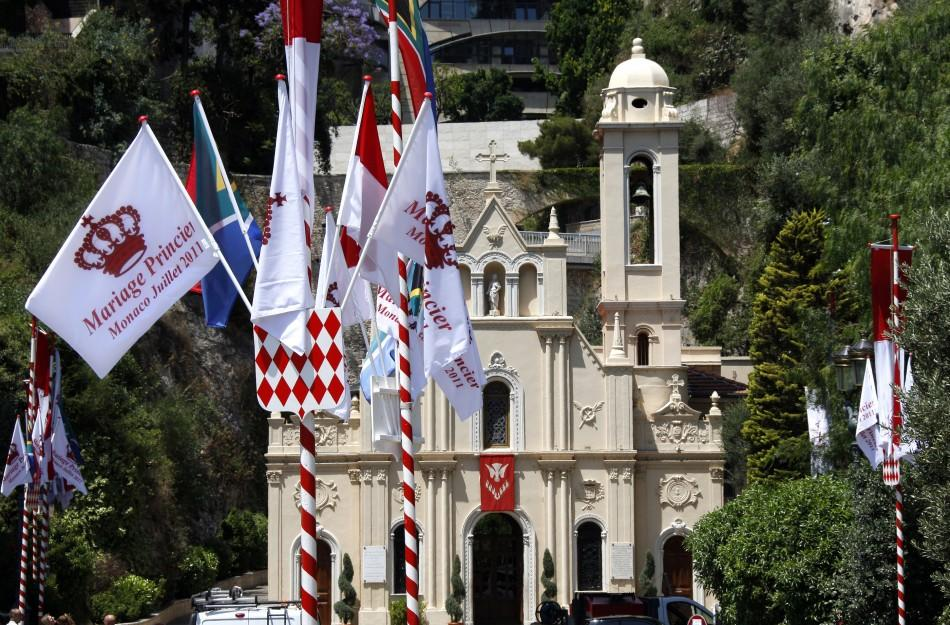 A flag announcing the upcoming Royal wedding is seen outside the Sainte Devote church in Monaco