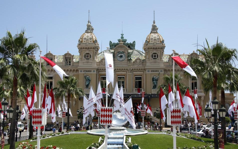 Flags announcing the wedding of Prince Albert II of Monaco and his fiancee Charlene Wittstock are seen at the Monaco Casino square
