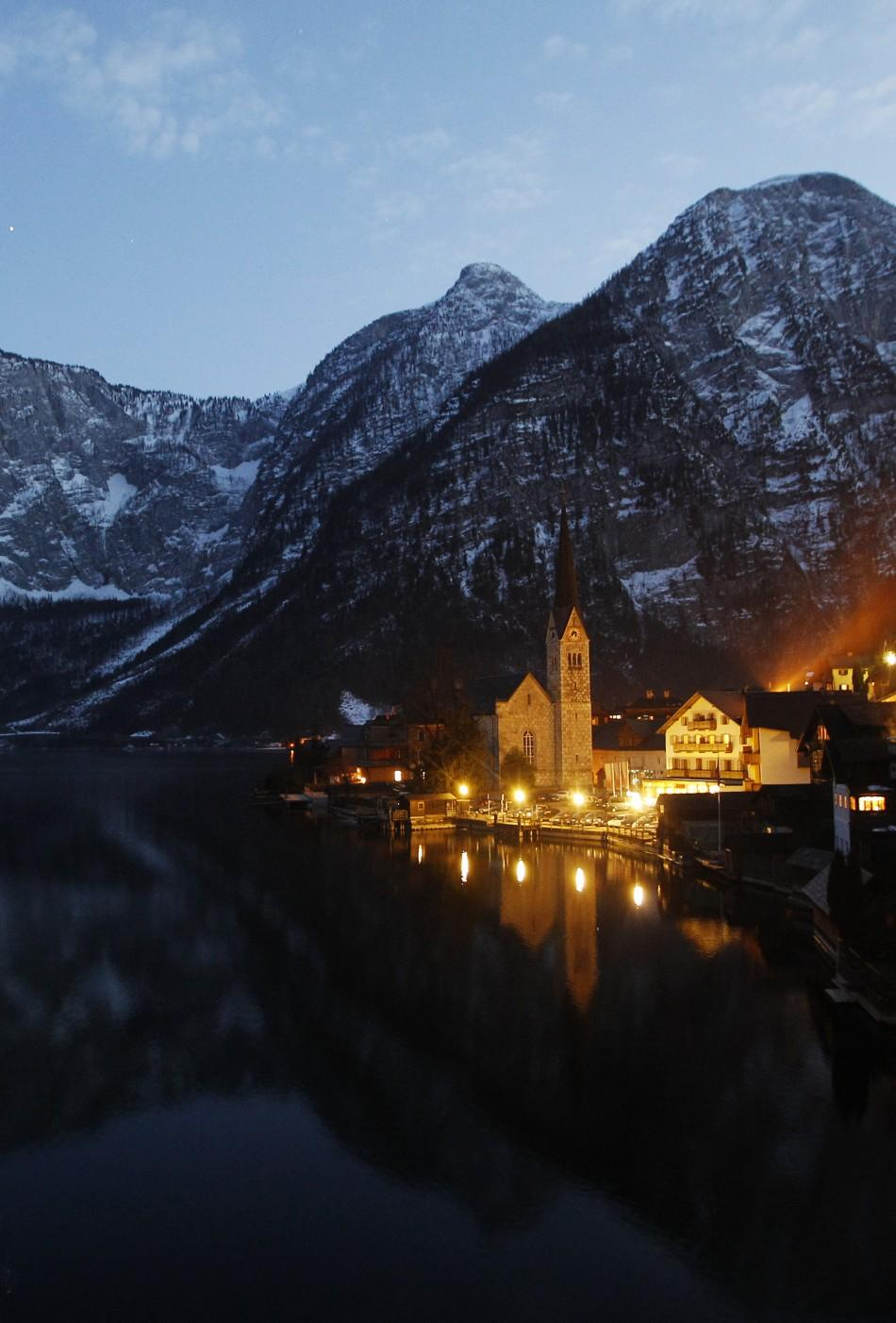 The village of Hallstatt and Lake Hallstaetter (Hallstaettersee) are seen in the province of Upper Austria