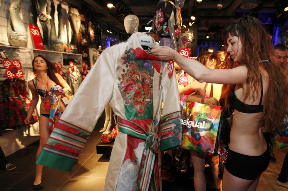 A shopper in her underwear searches for items at a Desigual store in central Prague