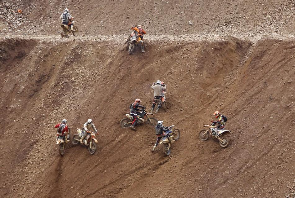Motocross riders participate in the 'Red Bull Hare Scramble' race during Erzberg Rodeo near the village of Eisenerz