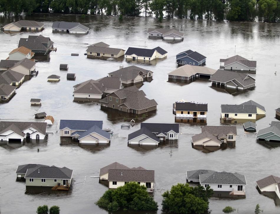 Newer houses on the southwest side of Minot, North Dakota, are seen submerged in flood waters