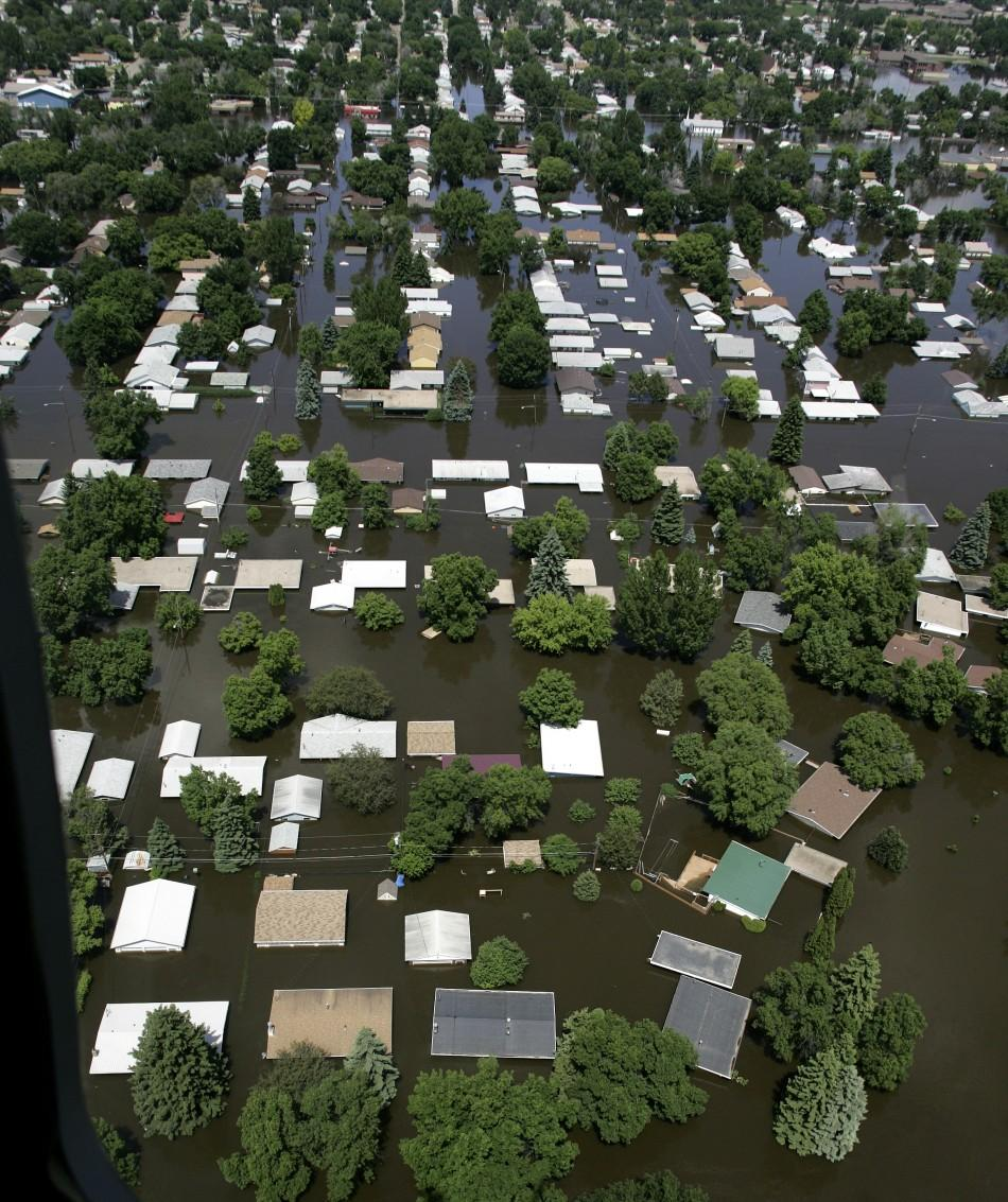 Houses in Minot, North Dakota are seen submerged in flood waters