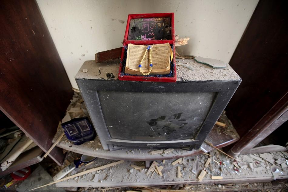 A copy of the Koran sits on top of a television after a rocket strike on a house in the centre of the rebel-held city of Misrata