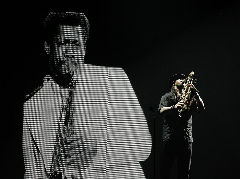 A saxophone player performs in memoriam to Clarence Clemons, the saxophonist in Bruce Springsteen's band who died recently, at the 2011 BET Awards in Los Angeles June 26, 2011.