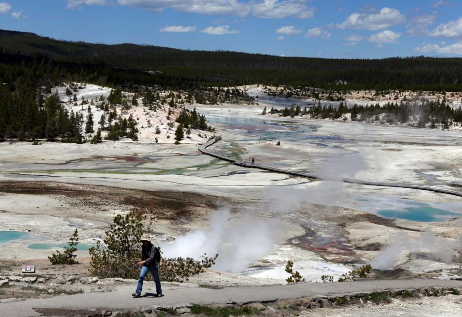 A hiker walks out of the Norris Geyser Basin