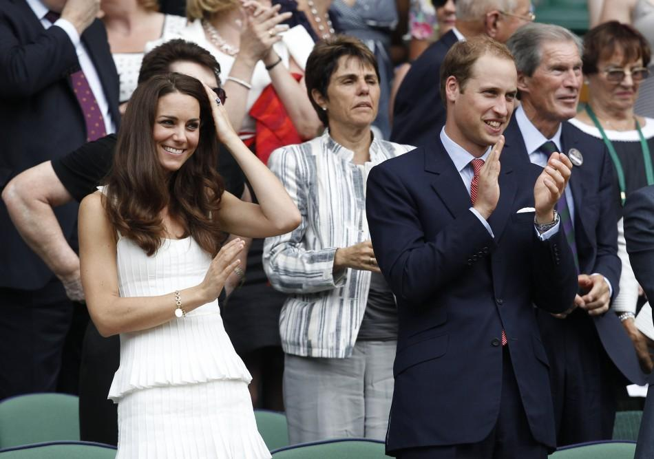 Kate and William waving and applauding