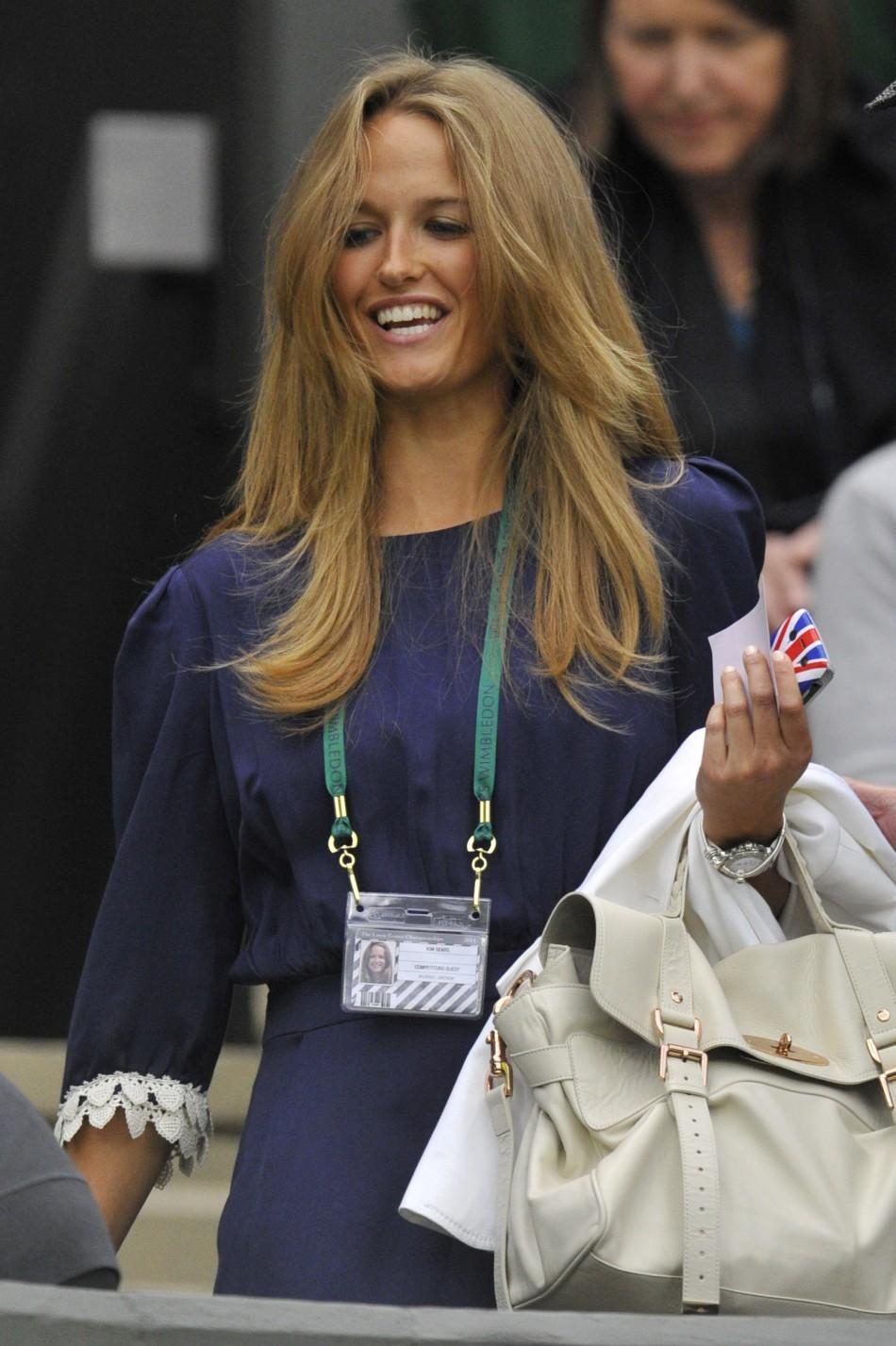 Kim Sears, the girlfriend of Andy Murray of Britain, arrives on Centre Court for the match between Murray and Ivan Ljubicic of Croatia at the Wimbledon tennis championships in London
