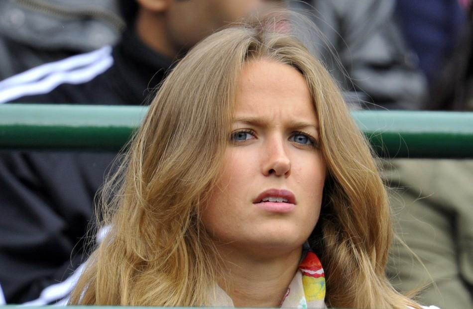 Kim Sears, the girlfriend of Andy Murray of Britain, sits on Court 1 to watch Murray's match against Tobias Kamke of Germany at the Wimbledon tennis championships in London