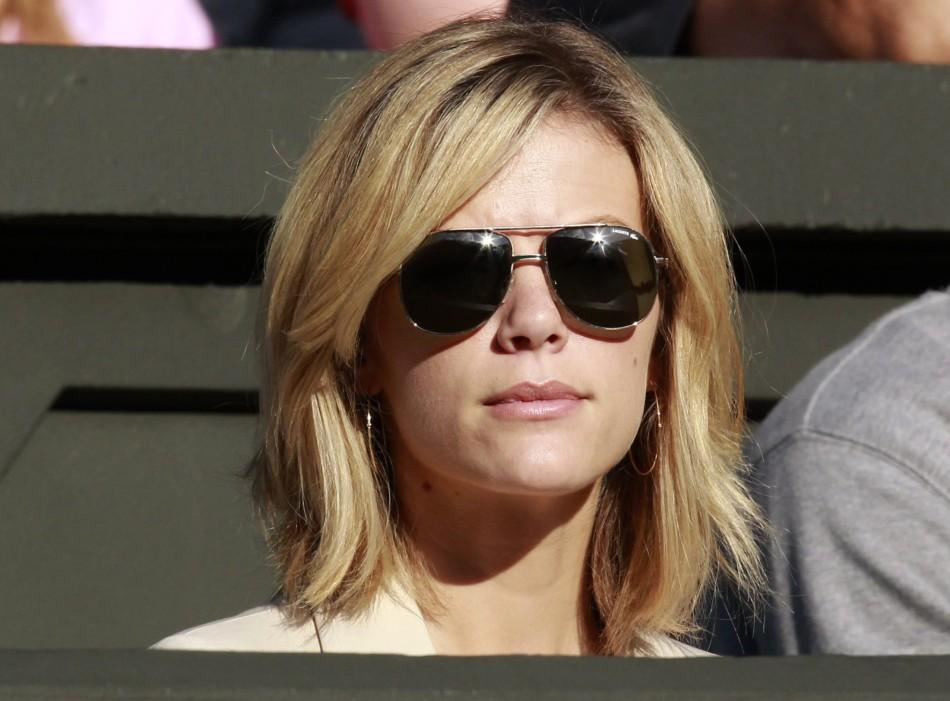 Brooklyn Decker, the wife of Andy Roddick of the U.S., sits on Centre Court for Roddick's match against Victor Hanescu of Romania at the Wimbledon tennis championships in London
