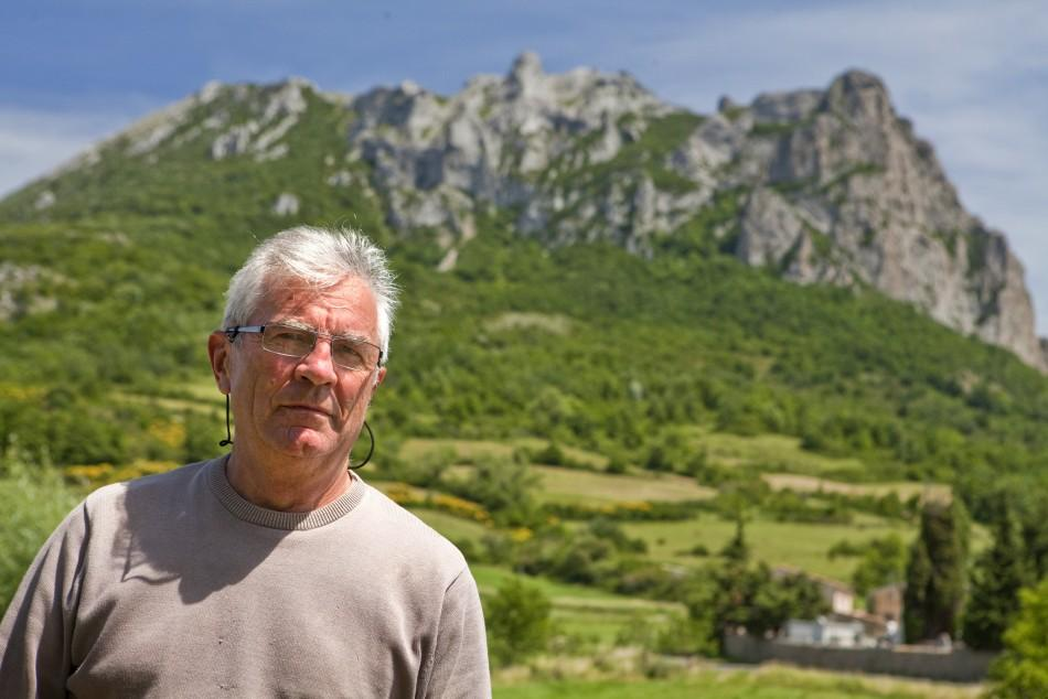 Jean-Pierre Delord, mayor of the village of Bugarach, poses in front of the peak, the high point of the Corbieres massif,