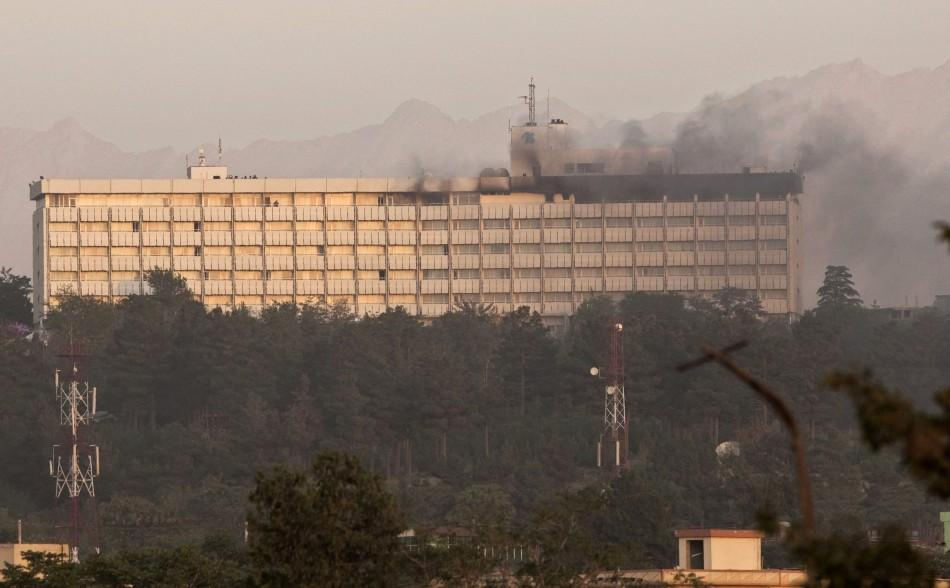 Smoke billows from the Intercontinental hotel during a battle between Afghan security forces and suicide bombers and Taliban insurgents in Kabul