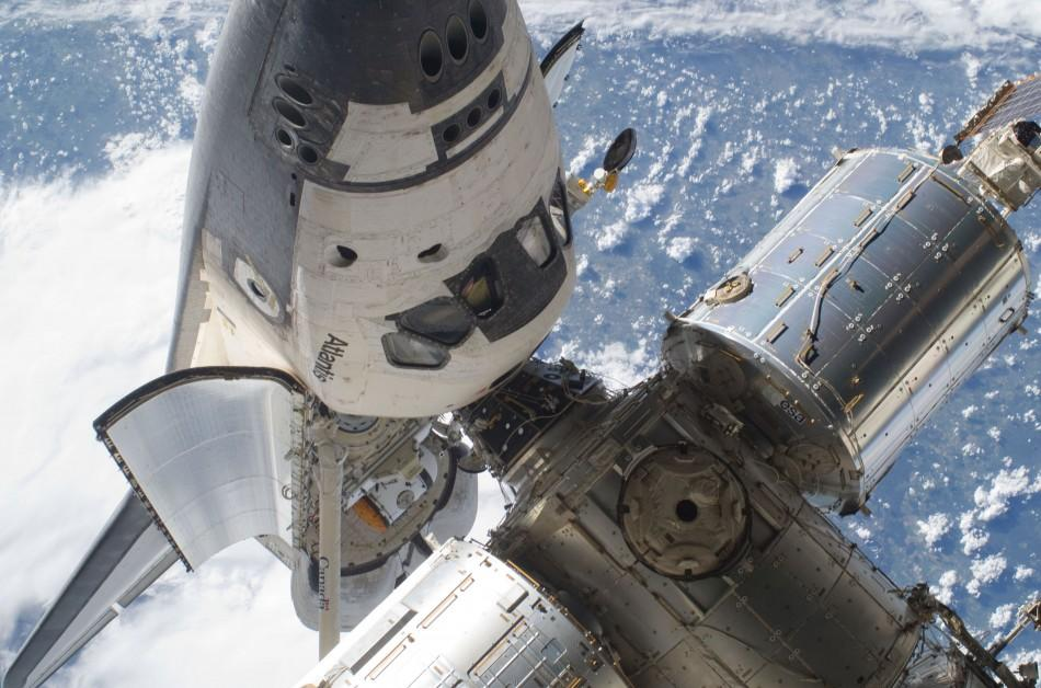 The Space Shuttle Atlantis (STS-132) and part of the International Space Station are seen while the two spacecraft remain docked in this NASA handout photo dated May 17, 2010.