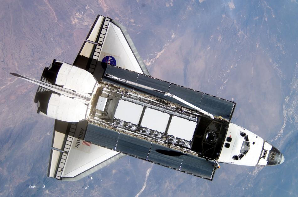 The Space Shuttle Atlantis is seen from the International Space Station (ISS) during rendezvous and docking operations in this NASA handout photo dated October 9, 2002.