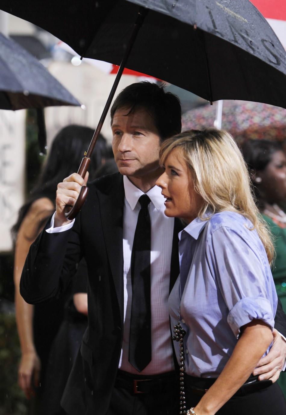 Actress Tea Leoni (R) and husband David Duchovny arrive at the 67th annual Golden Globe Awards in Beverly Hills, California January 17, 2010.